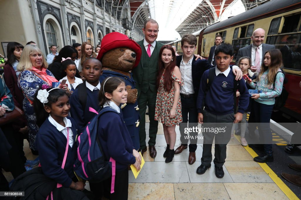 Actor Hugh Bonneville stands next to a costumed figure of Paddington bear on platform 1 at Paddington Station as he waits for the Duke and Duchess of Cambridge and Prince Harry to attend the Charities Forum event, joining children from the charities they support onboard the Belmond British Pullman train at Paddington Station supports onboard the Belmond British Pullman train and to also meet the cast and crew from the forthcoming film Paddington 2 at Paddington Station on October 16, 2017. (Photo by Jonathan Brady - WPA Pool/Getty Images) read: Jonathan Brady/PA Wire