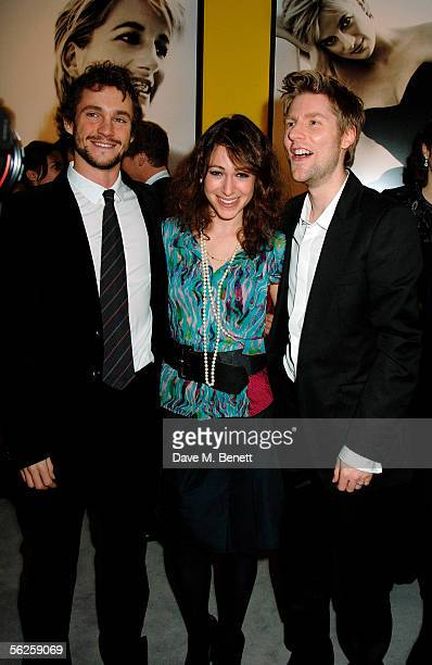 Actor Hugh Dancy Annie Morris and fashion designer and Design Director for Burberry Christopher Bailey attend the private view and champagne...