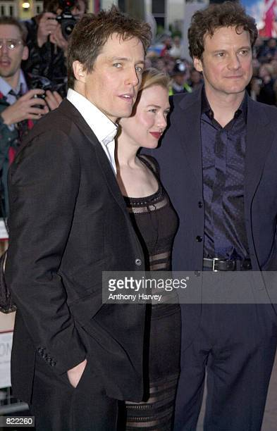 Actor Hugh Grant actress Renee Zellweger and Colin Firth pose for photographers as they arrive at the premiere of Bridget Jones'' Diary April 2001 in...