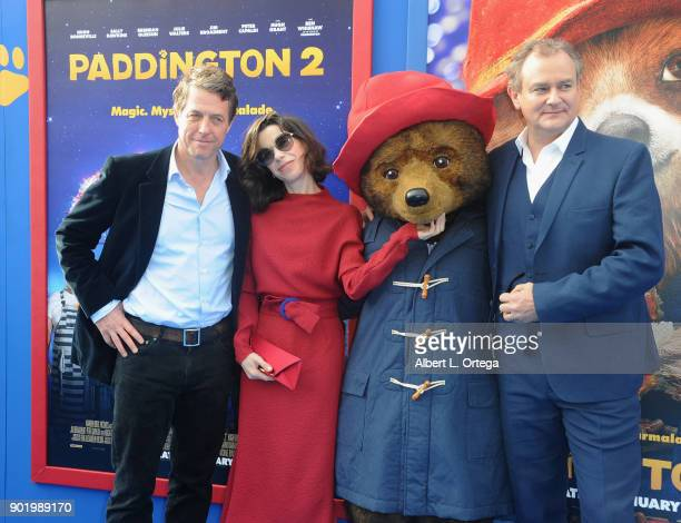 Actor Hugh Grant actress Sally Hawkins Paddington and actor Hugh Bonneville arrive for the premiere of Warner Bros Pictures' Paddington 2 held at...
