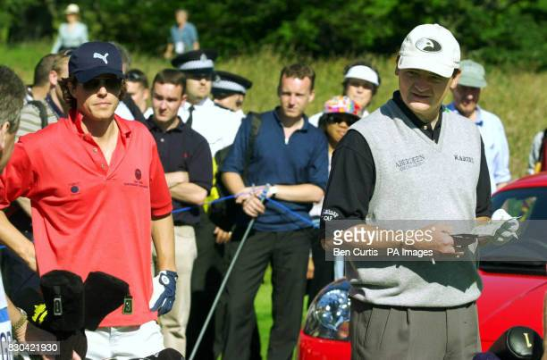 Actor Hugh Grant and 1999 Open winner Paul Lawrie on the course during the Roxburghe Challenge 2000 at the Roxburgh Golf Course near Kelso Scotland...
