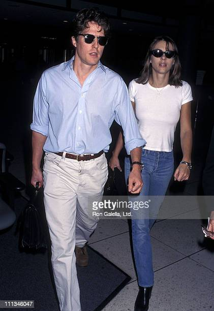 Actor Hugh Grant and actress Elizabeth Hurley depart for New York City on November 6, 1997 at Los Angeles International Airport in Los Angeles,...
