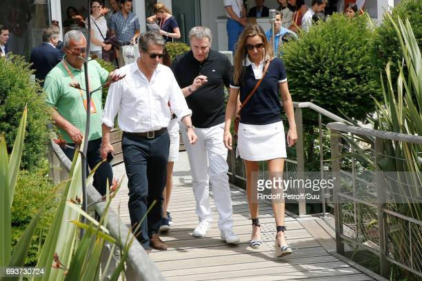 Actor Hugh Grant and Anna Eberstein arrive at the 2017 French Tennis Open Day Twelve at Roland Garros on June 8 2017 in Paris France
