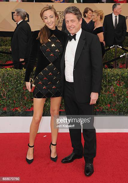 Actor Hugh Grant and Anna Eberstein arrive at the 23rd Annual Screen Actors Guild Awards at The Shrine Expo Hall on January 29 2017 in Los Angeles...