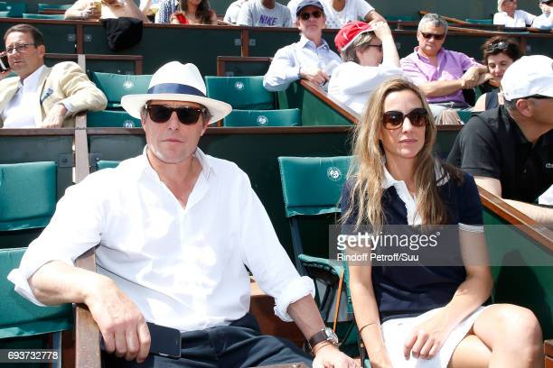 Actor Hugh Grant and Anna Eberstein attend the 2017 French Tennis Open Day Twelve at Roland Garros on June 8 2017 in Paris France