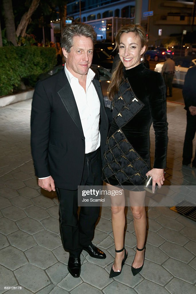 Actor Hugh Grant (L) and Anna Elisabet Eberstein attend The Weinstein Company & Netflix's SAG 2017 After Party presented by Audi at Sunset Tower Hotel on January 29, 2017 in West Hollywood, California.