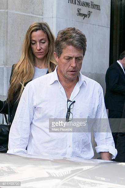 Actor Hugh Grant and Anna Elisabet Eberstein leave the 'Four Seasons George V' on October 1 2016 in Paris France