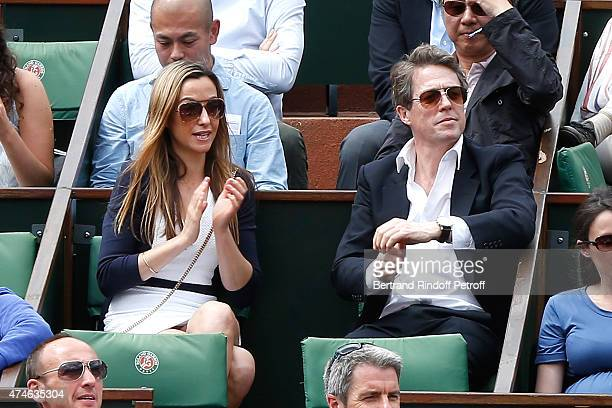 Actor Hugh Grant and Guest attend the 2015 Roland Garros French Tennis Open at Roland Garros on May 24 2015 in Paris France