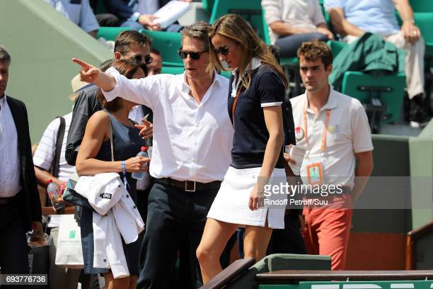 Actor Hugh Grant and his partner Anna Eberstein are spotted at Roland Garros on June 8 2017 in Paris France
