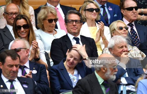 Actor Hugh Grant and his wife Anna Elisabet Eberstein attend the Royal Box during Day eleven of The Championships - Wimbledon 2019 at All England...