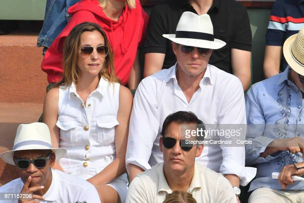 Actor Hugh Grant and his wife Anna Elisabet Eberstein attend the Men Final of the 2018 French Open Day Fithteen at Roland Garros on June 10 2018 in...