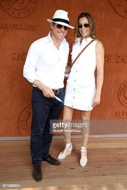Actor Hugh Grant and his wife AnneElisabet Eberstein attend the 2018 French Open Day Fifteen at Roland Garros on June 10 2018 in Paris France