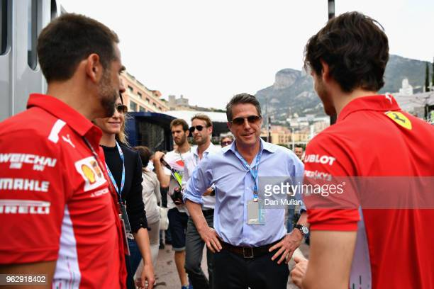 Actor Hugh Grant and his wife TV producer Anna Eberstein talk with Antonio Giovinazzi of Italy and Ferrari in the Paddock before the Monaco Formula...