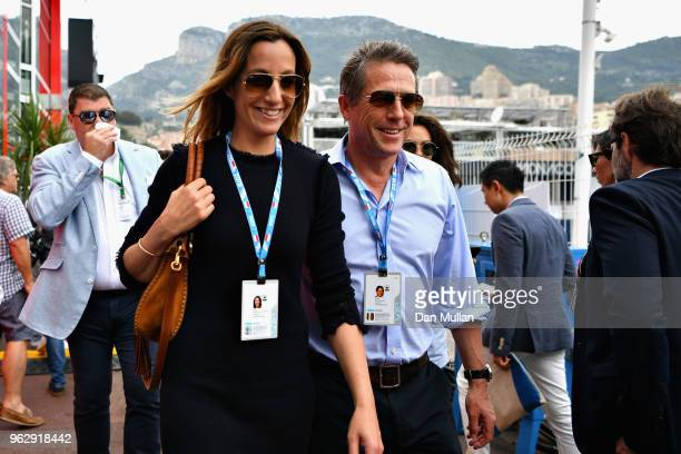 Actor Hugh Grant and his wife TV producer Anna Eberstein walk in the Paddock before the Monaco Formula One Grand Prix at Circuit de Monaco on May 27...