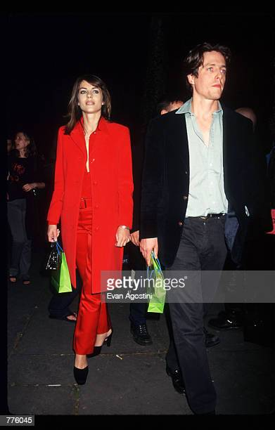 Actor Hugh Grant and model Elizabeth Hurley attend the Gianni Versace Spring 97 Fashion Show at 7th on Sixth October 26, 1996 in New York City. The...