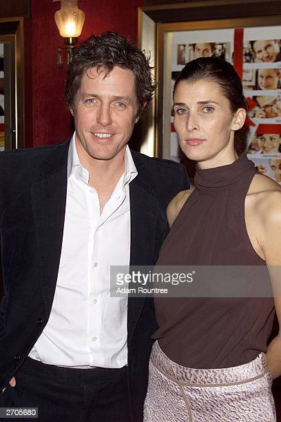 Actor Hugh Grant and Princess Rosario SaxeCoburg arrive for the premiere of Love Actually at The Ziegfeld Theater November 6 2003 in New York City