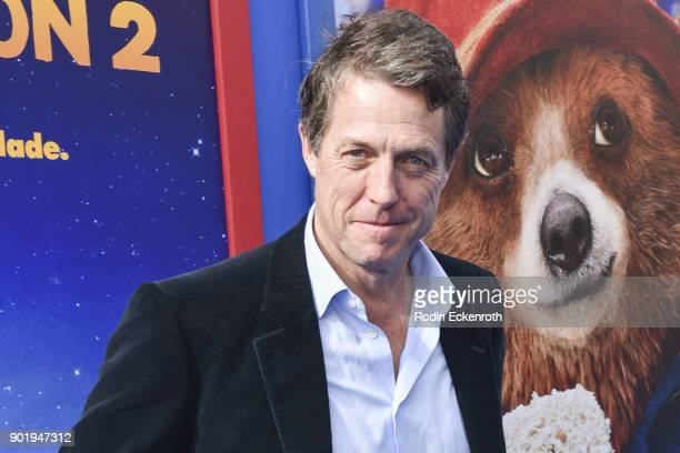 "Actor Hugh Grant arrives at the premiere of Warner Bros. Pictures' ""Paddington 2"" at Regency Village Theatre on January 6, 2018 in Westwood,..."