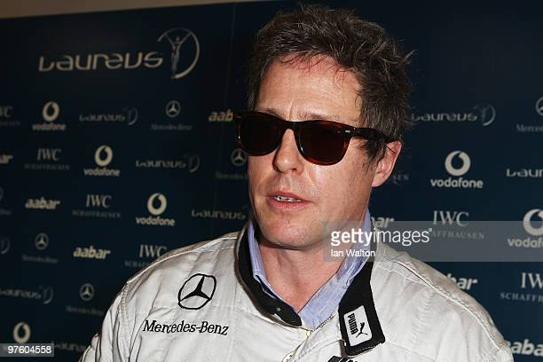 Actor Hugh Grant attends the Laureus Driving Experience for Good part of the Laureus Sports Awards 2010 at Yas Marina Circuit on March 10 2010 in Abu...