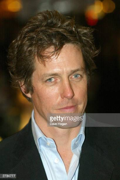 "Actor Hugh Grant attends the UK charity film premiere of ""Love Actually"" at The Odeon Leicester Square on November 16, 2003 in London."