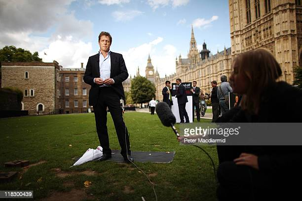 Actor Hugh Grant gives a television interview in support of the Hacked off campaign group near Parliament on July 6 2011 in London England The Prime...