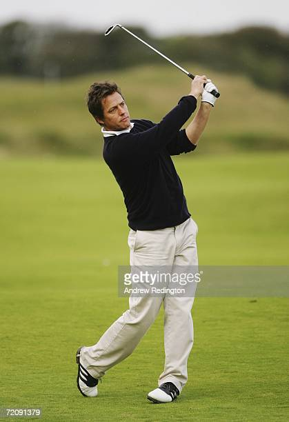 Actor Hugh Grant plays his second shot on the 11th Hole during the First Round of The Alfred Dunhill Links Championship at Kingsbarns Golf Club on...
