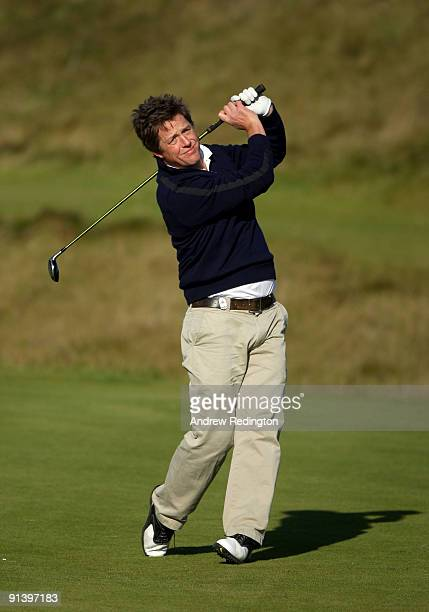 Actor Hugh Grant plays his second shot on the fifth hole during the third round of The Alfred Dunhill Links Championship at Kingsbarns Golf Links on...