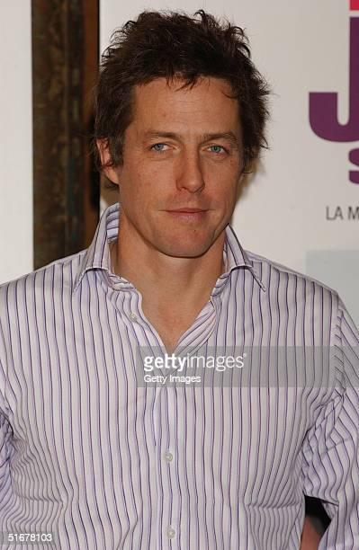 Actor Hugh Grant poses at a photocall to promote film Bridget Jones The Edge Of Reason at Hotel Ritz on November 5 2004 in Madrid Spain