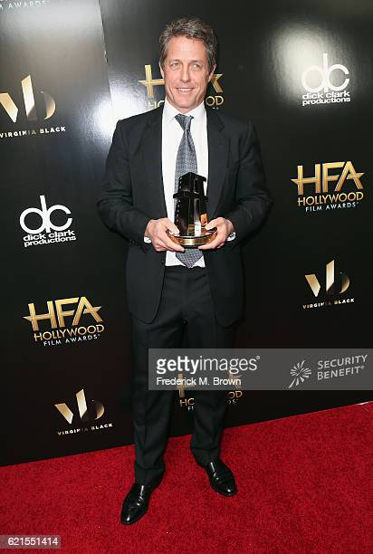 "Actor Hugh Grant, recipient of the ""Hollywood Supporting Actor Award"" for ""Florence Foster Jenkins"", poses in the press room at the 20th Annual..."