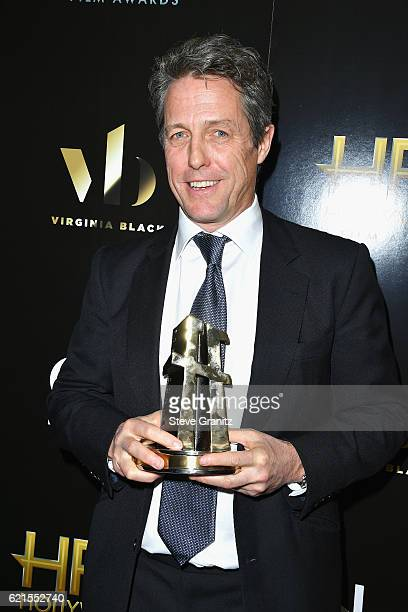 Actor Hugh Grant recipient of the Hollywood Supporting Actor Award for Florence Foster Jenkins poses in the press room at the 20th Annual Hollywood...