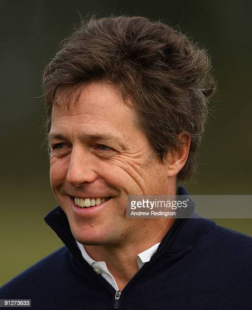 Actor Hugh Grant smiles during the final practice round of The Alfred Dunhill Links Championship at Kingsbarns Golf Links on September 30, 2009 in...