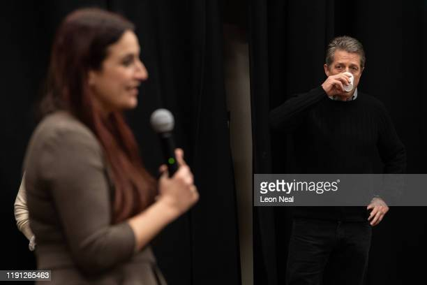Actor Hugh Grant watches candidate Luciana Berger during a Liberal Democrat campaign event in Finchley on December 1 2019 in London England UK voters...