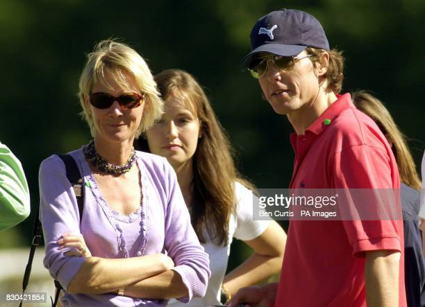 Actor Hugh Grant with the Duke of Roxburghe's daughter Roseanna InnesKerr and Virginia Duchess of Roxburghe at the Roxburghe Challenge 2000 a...