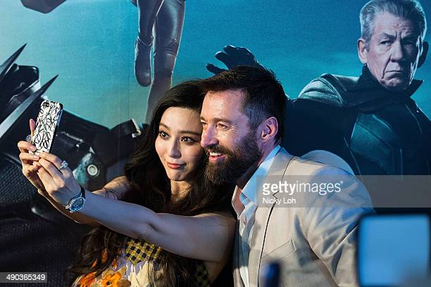 Actor Hugh Jackman and actress Fan Bingbing attend the XMEN Days of Future Past Southeast Asia Premiere on May 14 2014 in Singapore