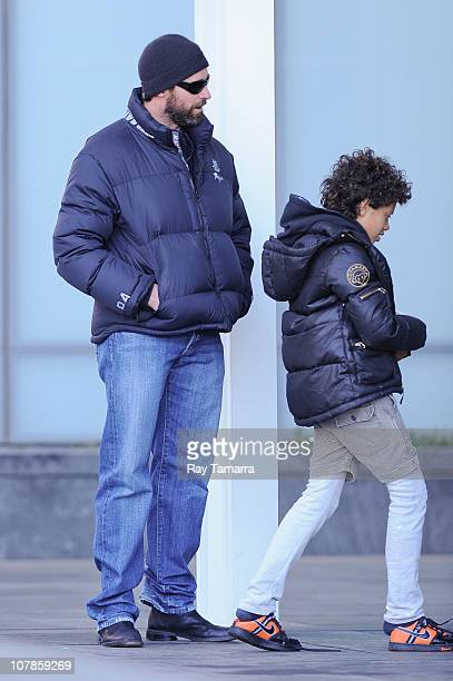Actor Hugh Jackman and his son Oscar Jackman leave their West Village apartment on January 3 2011 in New York City