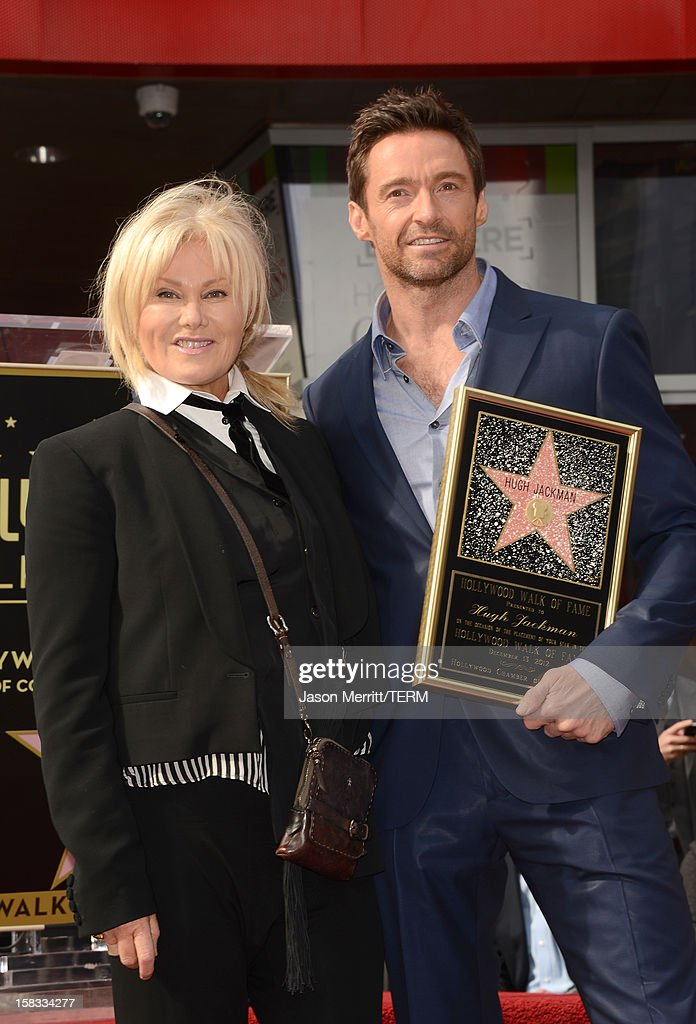 Actor Hugh Jackman and his wife Deborra-Lee Furness pose as Hugh Jackman is honored with a star on The Hollywood Walk Of Fame on December 13, 2012 in Hollywood, California.