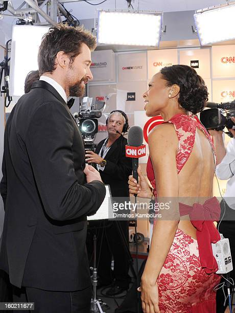 Actor Hugh Jackman and reporter Nischelle Turner attend the 19th Annual Screen Actors Guild Awards at The Shrine Auditorium on January 27 2013 in Los...