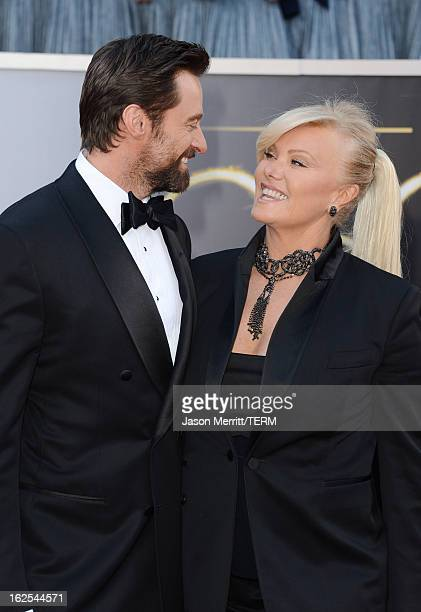 Actor Hugh Jackman and wife DeborraLee Furness arrive at the Oscars at Hollywood Highland Center on February 24 2013 in Hollywood California