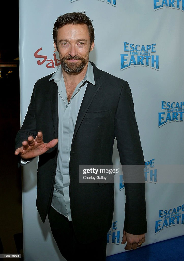 Actor Hugh Jackman attends the 'Escape From Planet Earth' premiere presented by The Weinstein Company in partnership with Sabra at Mann Chinese 6 on February 2, 2013 in Los Angeles, California.