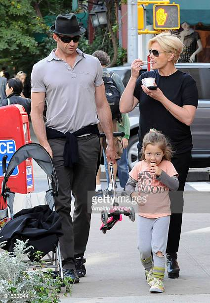 Actor Hugh Jackman his wife DeborraLee Furness and their daughter Ava walk in the West Village on October 6 2009 in New York City