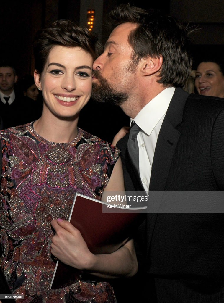 Actor Hugh Jackman (R) kisses actress Anne Hathaway during the 65th Annual Directors Guild Of America Awards at Ray Dolby Ballroom at Hollywood & Highland on February 2, 2013 in Los Angeles, California.