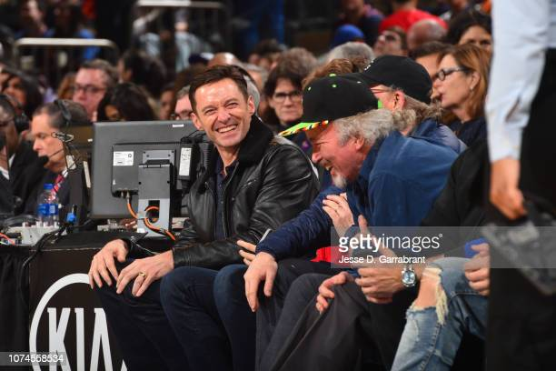 Actor Hugh Jackman laughs during a game between the Atlanta Hawks and the New York Knicks on December 21 2018 at Madison Square Garden in New York...