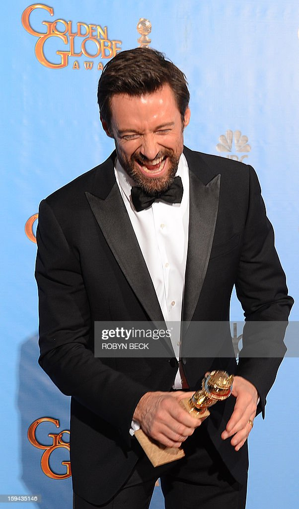 Actor Hugh Jackman poses in the press room with his Best Performance by an actor in a motion picture comedy or musical award for 'Les Miserables'at the Golden Globes awards ceremony in Beverly Hills on January 13, 2013. AFP PHOTO/Robyn BECK