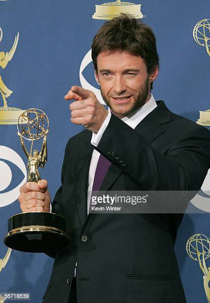 Actor Hugh Jackman poses with his Emmy for Outstanding Individual Performance in a Variety or Music Program in the press room at the 57th Annual Emmy...