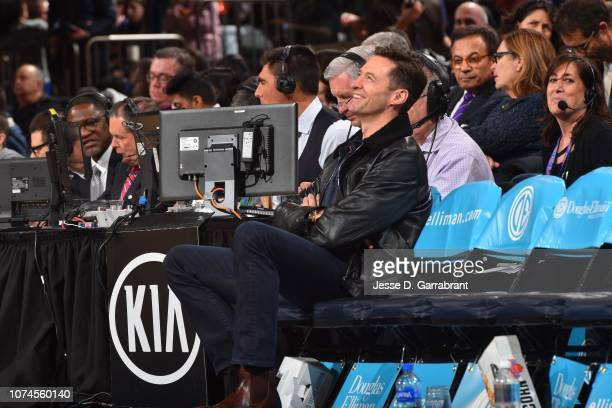 Actor Hugh Jackman smiles during a game between the Atlanta Hawks and the New York Knicks on December 21 2018 at Madison Square Garden in New York...