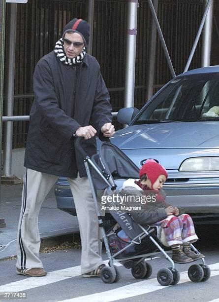 Actor Hugh Jackman walks with his adopted son Oscar Maximillian Jackman in the Soho neighborhood November 10 2003 in New York City