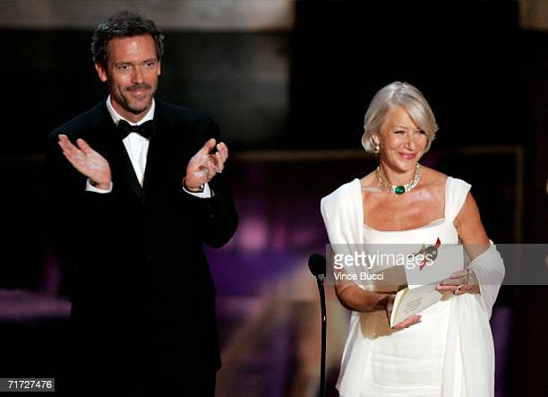 Actor Hugh Laurie and Actress Helen Mirren present the award for Outstanding Lead Actor in a Miniseries or Movie onstage at the 58th Annual Primetime...