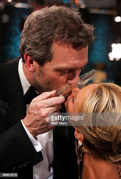 Actor Hugh Laurie and reporter Nancy O'Dell kiss at Access Hollywood Kiss For A Cause benefiting the Film Foundation and the Hollywood Museum at the...