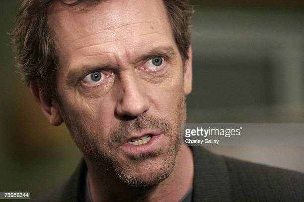 Actor Hugh Laurie attends the announcement of the creation of exclusive ''Houseism'' tshirts to benefit the National Alliance on Mental Illness on...