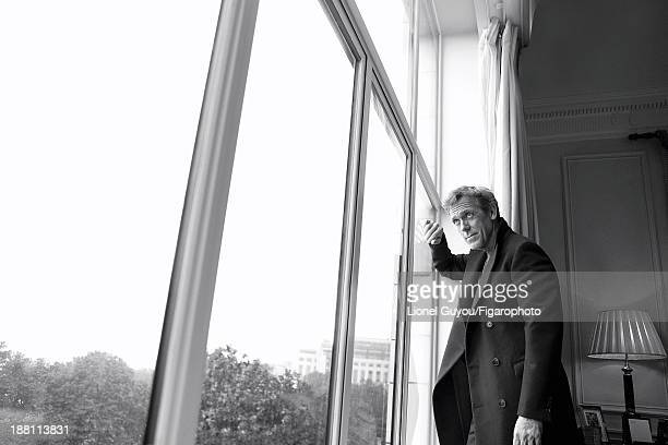 107663004 Actor Hugh Laurie is photographed for Madame Figaro on October 3 2013 in London England Coat tshirt jeans PUBLISHED IMAGE CREDIT MUST READ...
