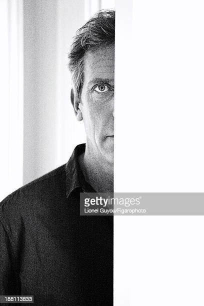 107663005 Actor Hugh Laurie is photographed for Madame Figaro on October 3 2013 in London England Shirt CREDIT MUST READ Lionel...